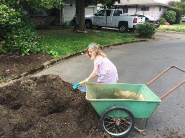 Amelia shoveling.