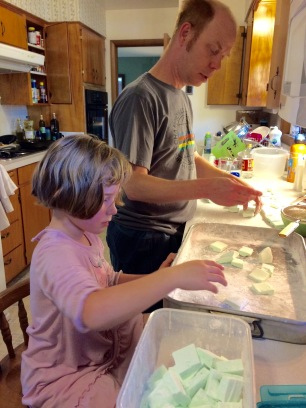 Amelia got to coat the candy in the cornstarch mixture so they wouldn't stick to each other