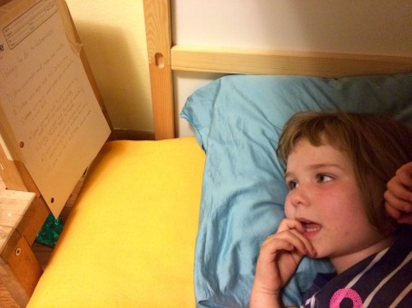 Amelia seeing if she can read the list from bed.